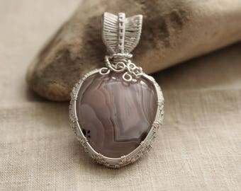 Agate pendant wrapped in non-tarnish silver plated wire