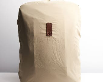 Beige Rain Cover Perfect Fit For Capra Backpacks. Fashionable Matte Waterproof Material. Packs Into Its Own Attached Case. Waterproof Bag