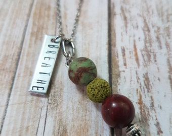 Essential oil hand stamped lava bead diffuser necklace breathe