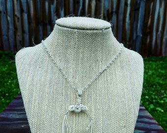 Silver wire wrapped eyeglass lens pendant necklace