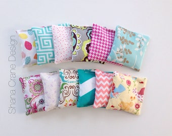 12 Rice Pillows . Various Colors