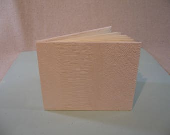 Small White Embossed Sketch Journal Made from One Folded Page.  Item # 2015.