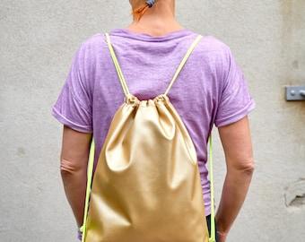 Gold backpack, sports bag, imitation leather