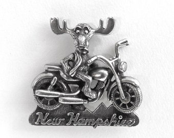 """Motorcycle riding Markie Moose tac pin """"New Hampshire"""" - moose ridin' a big V twin machine through the hills of the Granite State"""