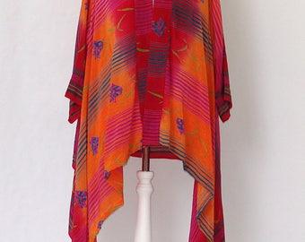 A brilliant silk Jacket in a Fiery Red Orange Print