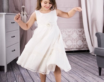 Tea length first communion dress in white or ivory made of cotton satin with flower and lace.