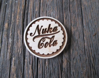 Nuka Cola pins or magnets