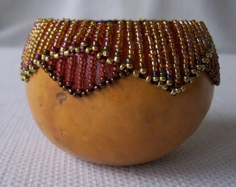 Small gourd bowl dyed and beaded rim. 1501.