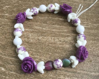 Purple and white floral stretch bracelet with stone roses