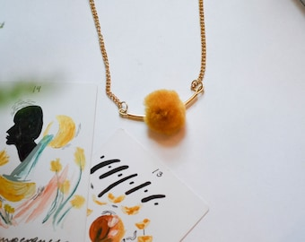 Gold Tube Necklace with Mustard Yellow Pom Pom