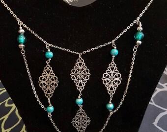 Blue damask necklace. Great for a V-neck shirt