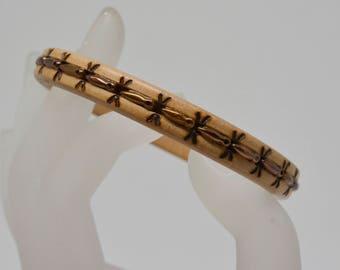 Lovely copper tone plastic bangle bracelet