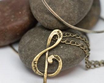 Steampunk skull treble clef necklace, antique bronze charm necklace