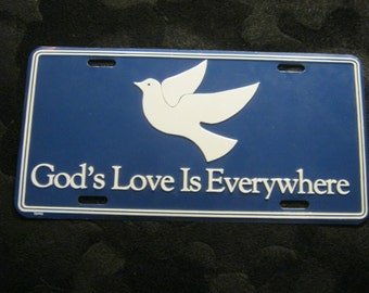 Advertising sign God's love is Everywhere + dove, blue White, ca. 1970 +/-, Metal