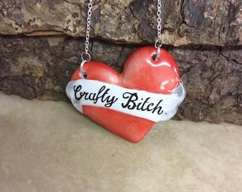 Handmade ceramic heart pendant on necklace