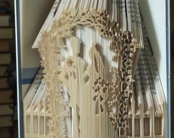 Bride and Groom under floral arch wedding book folding pattern