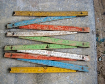 A vintage French folding ruler, multicoloured folding ruler, 2 metre ruler, yellow, red, blue, white, green