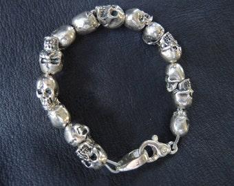 Heavy 15 Skull Sterling Silver Bracelet