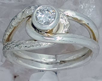 Hand Created Solid Sterling Silver Ring set with a .15ct.  Diamond