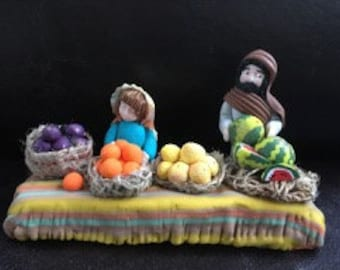 Fruit and vegetable merchant and his son. Nativity scene with polymer clay