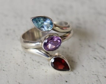 Sterling Silver. Gorgeous Sterling Silver with Red Garnet, Blue Topaz, and Amethyst Ring. Sizes 6, 7, 8