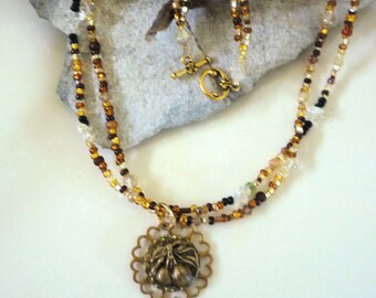 Double strand beaded necklace with antique button accent