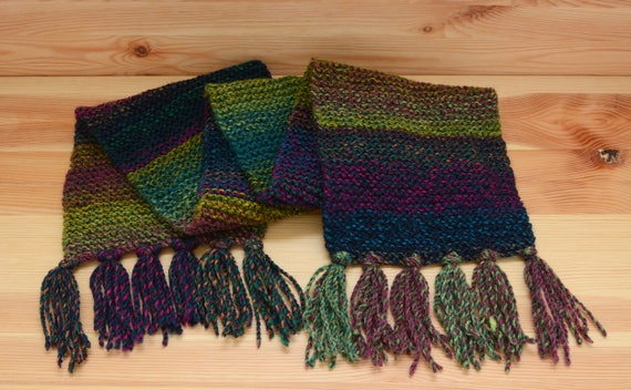 Colourful green and purple scarf with tassels