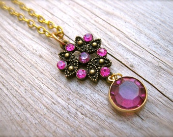 Necklace Plum Crystal Charm Necklace. Purple Rhinestone Encrusted Floral Charm. Antiqued Brass and Gold. Purple and Pink Necklace Jewelry