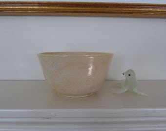 Small beige/yellow ice cream bowl.