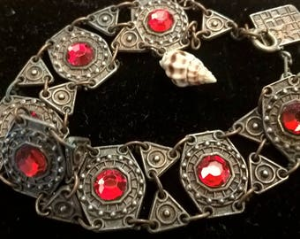 Vintage metal bracelet with red stone