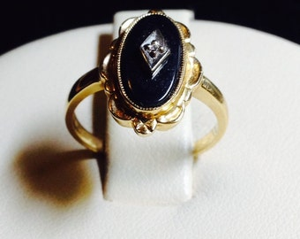 Women's onyx ring, 14k yellow gold with one 7 x 12 mm oval onyx, 3 grams, size 6; Gift for her.  Classic design