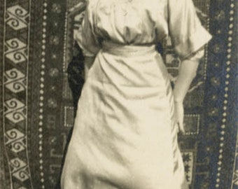 vintage photo 1922 Young Woman Rooftop Stands by Carpets Pillows
