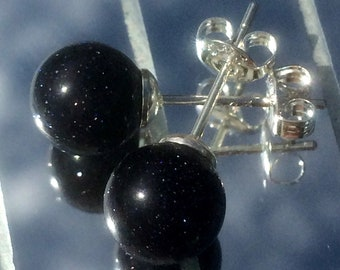 Blue goldstone and silver studs.