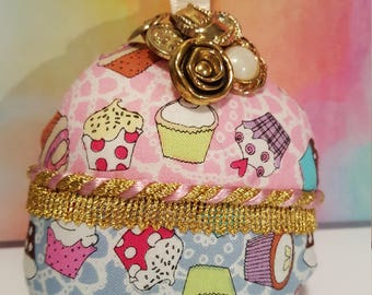 Handmade pink and blue cupcake decoration with gold button detail