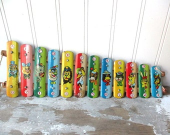 Vintage metal toy xylophone as is for wall hanging decor colorful animal graphics musical toy instrument
