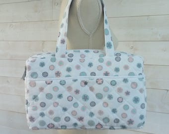 Diaper bag quilted printed fancy pink, grey and blue stars on white background
