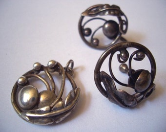 Vintage Mid-Century Pendant and Earring Set silver patina ... Inga loves to run through the field of flowers.