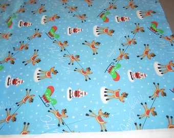 """Reindeer and Santas """"ho ho ho""""  on blue cotton fabric -  44""""wide - sold by the yard"""