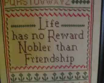Vintage cross stitch sampler with friendship verse