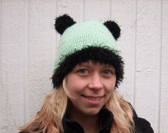 Hand knitted hat with furry pompom ears