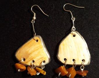 Earrings made of sea shells and amber