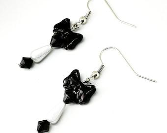White bow tie earrings