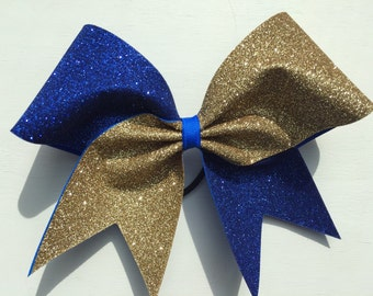 Vegas gold and royal blue glitter cheer bow.