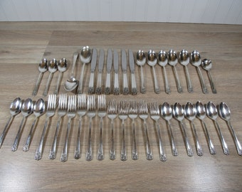 38 piece set of Wm Rogers silver plate flatware for one price- fine condition-April pattern