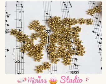50 beads spacers snowflake gold / gold n30738 8X7mm