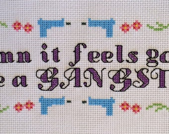 Damn It Feels Good To Be A Gangster Cross Stitch And Backstitch Pattern With Flowers, Hearts And Guns, Pattern Only