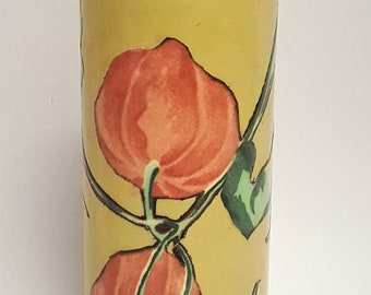 A vintage hand-painted multi media colored glass vase