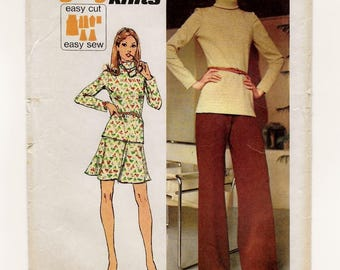 "A Long Sleeve, Roll Collar Tunic Top, Flared Elastic Waist Skirt and Wide Leg Pants Pattern for Women: Size 8 Bust 31-1/2"" • Simplicity 5841"