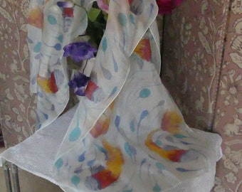 Hand painted 100% pure silk scarf of swimming fishes in yellows ,oranges, reds and blues.
