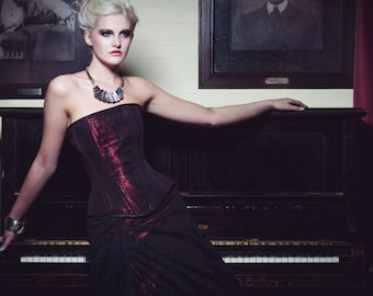 Red and black lace corset and full length skirt.